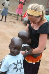 Alisha with children in Uganda