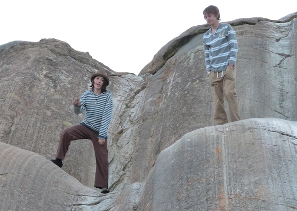 Enjoying the Natural Rock Slides at Sacsayhuamán [VIDEO]